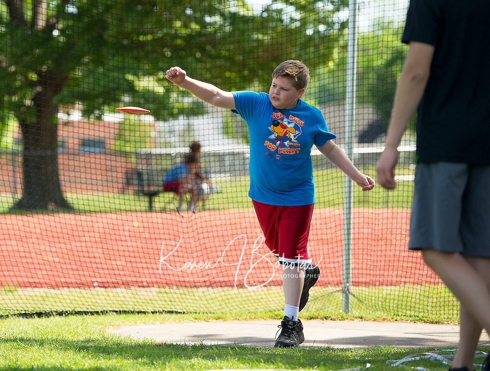 Daniel Harward of Elm Street School throws the discus during the 5th grade track meet at Opechee Park on Wednesday.  (Karen Bobotas/for the Laconia Daily Sun)