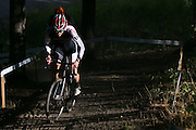 Riders climb a hill during the Men's Elite race at the Ellison Park Cyclocross Festival in Rochester on Saturday, October 11, 2014.