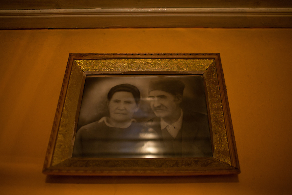 Pictures of Jefta's parents on the wall in their bedroom...Ljubica and Jeftine (Jefta) Gogic in their home in Velika Hoca. They have been married since 1954. She is 72 years old and he 80, and they have 3 sons who all live in Serbia. None could afford to return to their village for Christmas...Orthodox Christmas (January 7) in the Serbian village of Velika Hoca, Kosovo.