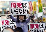 "Mone Shimane, 5, holds up a sign reading ""we don't need nuclear power"" as around 4,000 people take part in a demonstration  in Tokyo, Japan on  10 April 20011. .Photographer: Robert Gilhooly"