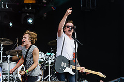 © Licensed to London News Pictures. 03/08/2012. London, UK.  McFly perform live at BT London Live, Hyde Park.  McFly are an English pop-rock band who first found fame in 2004. The band consists of Tom Fletcher (lead vocals, guitar and piano), Danny Jones (lead vocals and guitar), Dougie Poynter (backing vocals and bass guitar) and Harry Judd (drums). In this pic L to R - Tom Fletcher,Danny Jones.  Photo credit : Richard Isaac/LNP