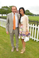 GEOFFREY KENT and his wife OTAVIA at the Cartier Queen's Cup Polo final at Guard's Polo Club, Smiths Lawn, Windsor Great Park, Egham, Surrey on 14th June 2015