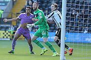 Plymouth Argyle defender Curtis Nelson  held by Notts County defender Elliot Hewitt during the Sky Bet League 2 match between Notts County and Plymouth Argyle at Meadow Lane, Nottingham, England on 11 October 2015. Photo by Simon Davies.