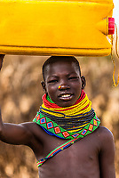 Nyangatom tribe people carrying water containers, Omo Valley, Ethiopia.