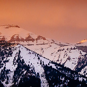 Sunset over the Rendezvous, No Name, and Cody Peaks as a winter storm clears.