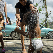 OCTOBER 25 - UTUADO, PUERTO RICO - <br /> Darian Santos, 1, is bathed in water  from a stream coming from a mountain in Utuado.<br /> (Photo by Angel Valentin/Freelance)