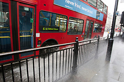 © licensed to London News Pictures. London, UK 09/04/2012. A bus splashing water to Regents Street as it goes into a pool on the road in central London, this afternoon (09/04/12). Photo credit: Tolga Akmen/LNP