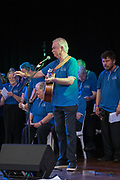Spirit of the Streets Choir and Bernard Carney onstage at the Guildford Town Hall, performing in the 2019 Guildford Songfest.