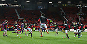 Manchester United team in warm up during the Barclays Premier League match between Manchester United and Stoke City at Old Trafford, Manchester, England on 2 February 2016. Photo by Phil Duncan.