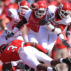 Apr 24, 2010; Piscataway, NJ, USA; Scarlet cornerback Darrell Givens (3) forces White running back Tyrone Putman (22) to fumble the ball during Rutgers Scarlet and White intersquad NCAA football scrimmage at Rutgers Stadium. The Scarlet squad defeated the White, 16-7.