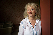 Photogrpaher Debbie Fleming Caffery stands for a portrait in the historic Hotel Casteneda.