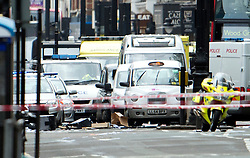 © London News Pictures. 27/04/2012. London, UK. Items thrown on to the road on Tottenham Court Road in Central London following reports of a hostage situation..  Photo credit : Ben Cawthra /LNP