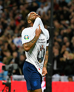 Goal - Raheem Sterling of England celebrates scoring a goal to give a 3-0 lead to the home team reavealing a t-shirt with the name Damary Dawkins during the UEFA European 2020 Qualifier match between England and Czech Republic at Wembley Stadium, London, England on 22 March 2019.