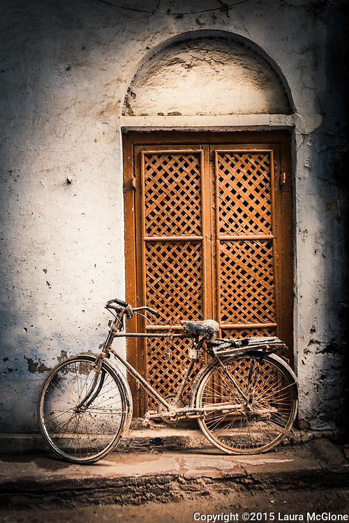 Lattice Doorway with old bicycle, India