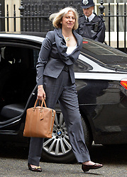© Licensed to London News Pictures. FILE PICTURE DATED 10/07/2012. Secretary of State for the Home Department THERESA MAY on Downing Street. Theresa May today (09/06/2014) met with Prime Minister David Cameron to discuss the alleged extremist takeover of schools in Birmingham. ThePhoto credit : Stephen Simpson/LNP