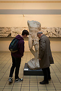 Visitors admire the Roman versions of hero warrior Protesilaos sculpture - the first Greek warrior to land and die in Troy, in the British Museum, on 11th April 2018, in London, England.