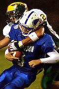 Ben Liu 9/17/04..San Ramon Valley's Albert Valle reaches oer and across for the ball and puts  Irvington's J.T. Ramos to a stop Friday night in Fremont.
