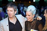 Noel Gallagher embraces Lily Allen