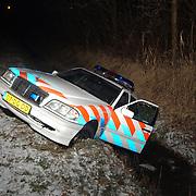Politieauto in de sloot na achtervolging rijksweg A1 afslag Baarn