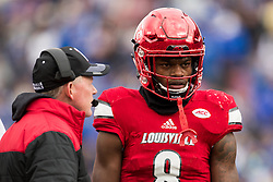 Louisville quarterback Lamar Jackson, right talks with Louisville head coach Bobby Petrino during a break in the action. The University of Louisville hosted Kentucky, Saturday, Nov. 26, 2016 at Papa John's Cardinal Stadium in Louisville. Kentucky won the game 41-38.