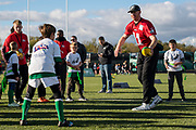 Philadelphia Eagles Carson Wentz QB (11) hands the ball off to a child during the flag event during the press, training and media day for Philadephia Eagles at London Irish Training Ground, Hazelwood Centre, United Kingdom on 26 October 2018. Picture by Jason Brown.
