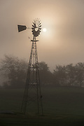 Windmill on a foggy morning in Rutland County, Vermont.