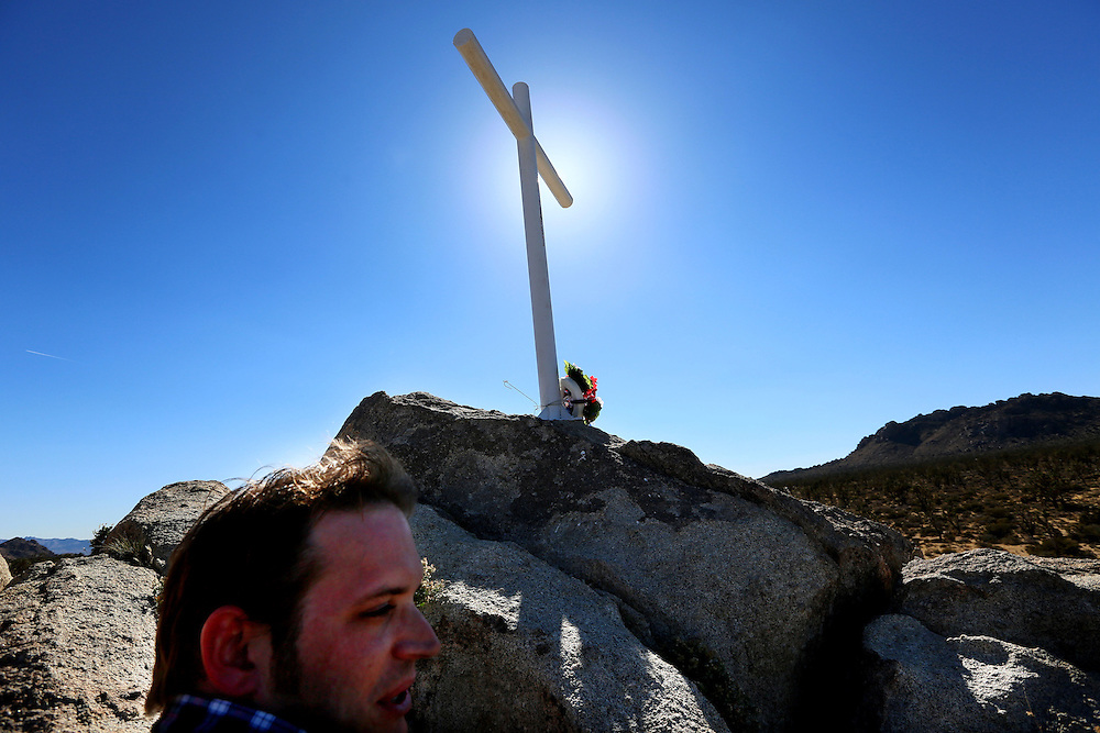 Supporters look over the cross during an unveiling ceremony for the Mojave Cross on Veterans Day in Cima, California on Sunday, November 11, 2012.  A battle has been brewing for over Thirteen years over whether the cross can legally stay on Sunrise Rock because it violates Separation of Church and State and is in the Mojave National Perserve which is on Federal Lands.  The Veterans of Foreign Wars and American Legion Society raised money to purchase the plot of land and has kept the cross in place and today serves as war memorial.(Photo by Sandy Huffaker)