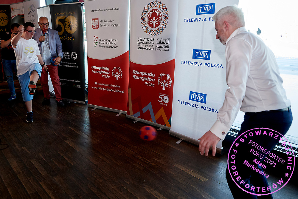 Warsaw, Poland - 2018 May 10: (L) Special Olympics Athete Cezary Kubik shoots on goal and (R) Maciej Stanecki saves while Special Olympics Press Conference at Marriott Champions Sport Bar on May 10, 2018 in Warsaw, Poland.<br /> <br /> Adam Nurkiewicz declares that he has no rights to the image of people at the photographs of his authorship.<br /> <br /> Picture also available in RAW (NEF) or TIFF format on special request.<br /> <br /> Any editorial, commercial or promotional use requires written permission from the author of image.<br /> <br /> Image can be used in the press when the method of use and the signature does not hurt people on the picture.<br /> <br /> Mandatory credit:<br /> Photo by &copy; Adam Nurkiewicz / Mediasport