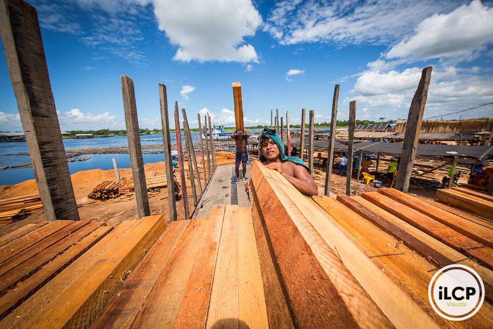 "The 'port' in Pucallpa which lines the city side of a side channel of the Ucayali River, is almost exclusively dedicated to saw mills for the regional timber industry. Logs from all the surrounding areas come by river to be processed and shipped out by truck on one of the few main highways over the Andes to markets on the coast. From a March 2015 expedition in the Peruvian Amazon up the Curanja River (Rio Curanja) visiting indigenous communities and the  Purús Communal Reserve (Reserva Comunal Purús) bordering the Alto Purús National Park (Parque Nacional Alto Purús) on assignment with Andrew Lawler, the Upper Amazon Conservancy, and Pro Purús for Science Magazine with support from the Pulitzer Foundation. Our goal was to look at the dynamics between local indigenous communities, Isolated Indigenous Communities (""Uncontacted"" tribes or Publeos Indigeneros en Asolado or PIAs) and protected areas for cultural and environmental conservation."
