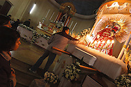 """Bolivia. Tarija. Festa di San Roque..Touch the saint to have a little 'of grace, which is typical of the """"universe"""" San Roque in Tarija."""