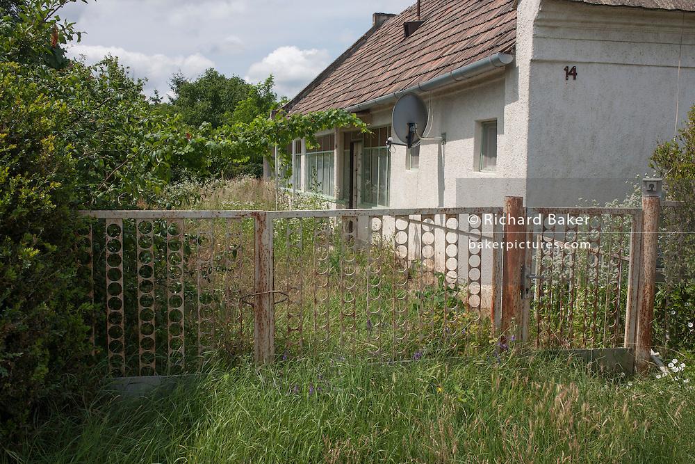 Abandoned land belonging to poor, rural housing near the town of Bakonyszentlaszlo, Gyor-Moson-Sopron, Hungary