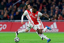 Quincy Promes #11 of Ajax in action during the Dutch Eredivisie match round 25 between Ajax Amsterdam and AZ Alkmaar at the Johan Cruijff Arena on March 01, 2020 in Amsterdam, Netherlands