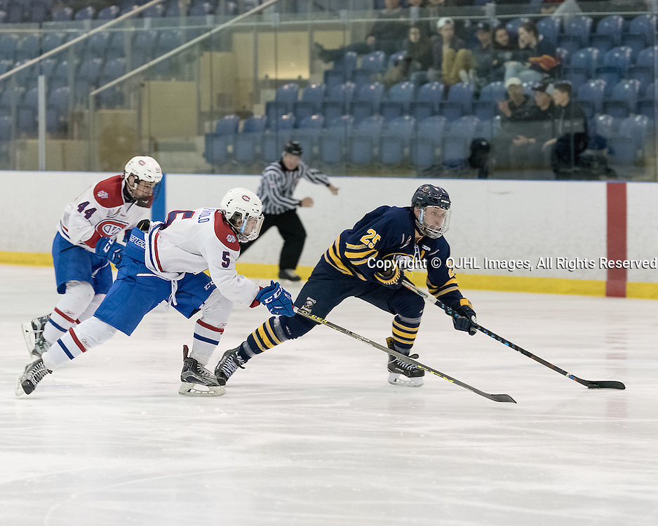 KINGSTON, ON - FEB 16,  2017: Ontario Junior Hockey League game between Buffalo Junior Sabres and Kingston Voyageurs, Ryan Cox #25 of the Buffalo Jr. Sabres skates with the puck while being pursued by Anthony Firriolo #5 of the Kingston Voyageurs during the second period.<br /> (Photo by Ian Dixon/ OJHL Images)
