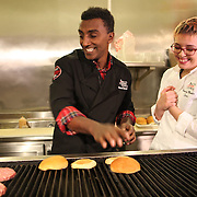 "Macy's celebrates ""Wishes Across America"" on Macy's National Believe Day, with Make-A-Wish® child Sara, 17, and Macy's Culinary Council chef Marcus Samuelsson at Macy's State Street store in Chicago Friday December 6, 2013 in Chicago. (Jose More/AP Images for Macy's)"