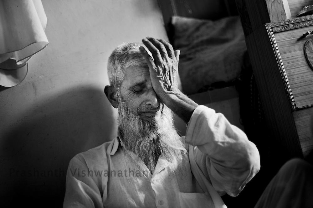 A fathers anguish on recalling the  night his son was taken away 15 years ago, September 2011, Kashmir, India. Photographer: Prashanth Vishwanathan