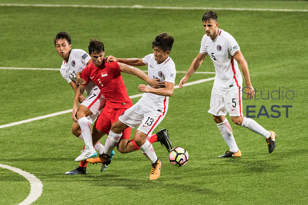 SINGAPORE, SINGAPORE - AUGUST 31: Ikhsan Fandi of Singapore (2nd from left) fights for the ball with Tan Chun Lok, Wong Tsz Ho, and Helio Conclaves of Hong Kong during the international friendly match between Singapore and Hong Kong at the Jalan Besar Stadium on August 31, 2017, in Singapore, Singapore. (Photo by Getty Images)