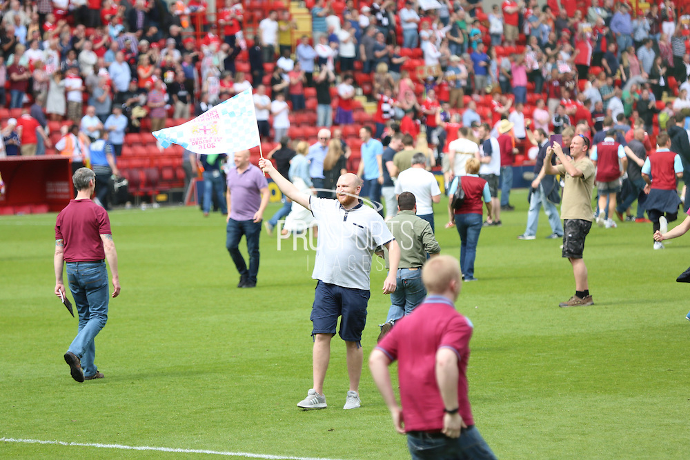 Burnley fans celebrating with pitch invasion during the Sky Bet Championship match between Charlton Athletic and Burnley at The Valley, London, England on 7 May 2016. Photo by Matthew Redman.