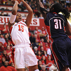 Mar 2, 2009; Piscataway, NJ, USA; Rutgers center Kia Vaughn (15) takes a shot over the block attempt by Connecticut center Tina Charles (31) during the second half of Rutgers game against nationally rated #1 Connecticut at the Louis Brown Athletic Center.  Connecticut won 69-59 to finish their regular season a perfect 30-0.