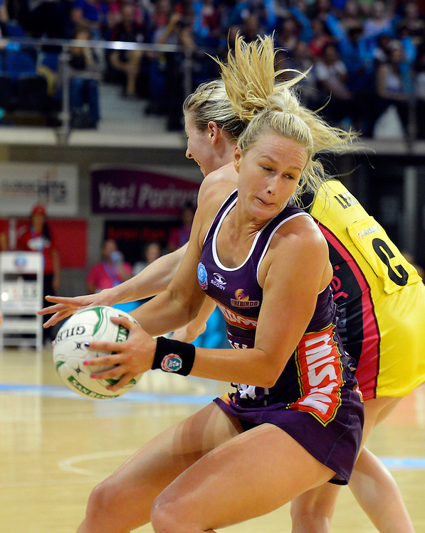 Firebirds Chelsea Pitman strips the Pulses Camilla Lees of the ball in the ANZ Netball Champions at te Ruaparaha Arena, Porirua, New Zealand, Monday, April 01, 2013. Credit:SNPA / Ross Setford