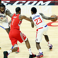 28 February 2018: LA Clippers guard Lou Williams (23) drives past Houston Rockets forward Trevor Ariza (1) on a screen set by LA Clippers center DeAndre Jordan (6) during the Houston Rockets 105-92 victory over the LA Clippers, at the Staples Center, Los Angeles, California, USA.