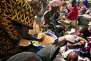 On market days, Fatoumata Toure stops cooking early to work with her co-wife Pama Kondo. They acquire and unload grain in bulk and then sell it in smaller quantities to individuals and families. Soumana Natomo spends much of his time overseeing his working wives. Occasionally, he makes a trip to their single-room storehouse to replenish the grain his wives are selling. Hungry Planet: What the World Eats (p. 211). The Natomo family of Kouakourou, Mali, is one of the thirty families featured, with a weeks' worth of food, in the book Hungry Planet: What the World Eats.