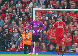 LIVERPOOL, ENGLAND - Saturday, September 27, 2014: Liverpool's goalkeeper Simon Mignolet looks dejected as he concedes an injury time equalising goal against Everton during the Premier League match at Anfield. (Pic by David Rawcliffe/Propaganda)