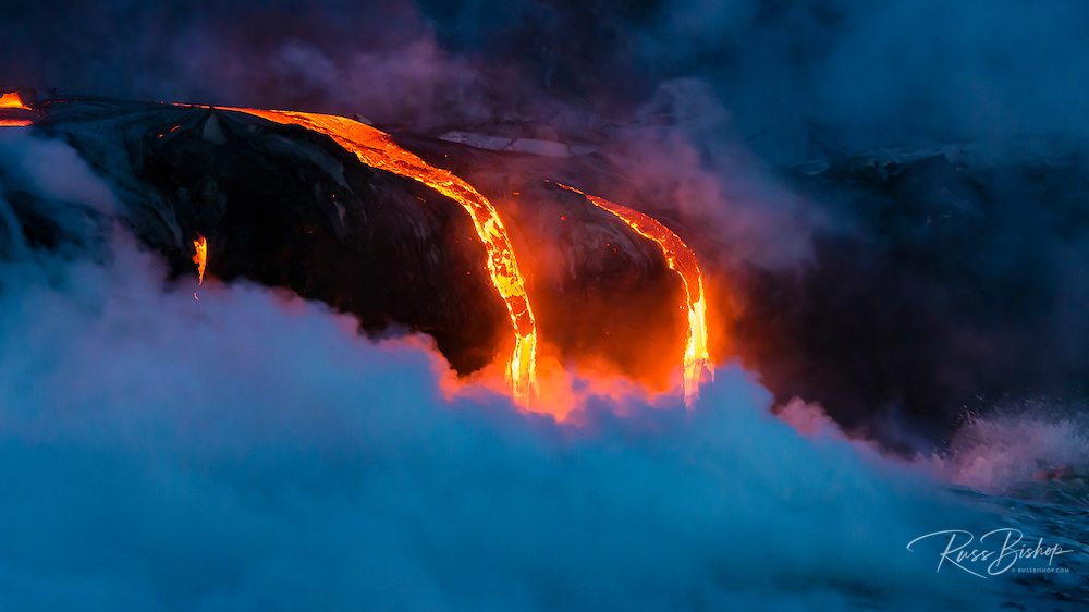 Lava flow entering the ocean at dawn, Hawaii Volcanoes National Park, The Big Island, Hawaii USA