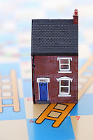 Plastic house on game board