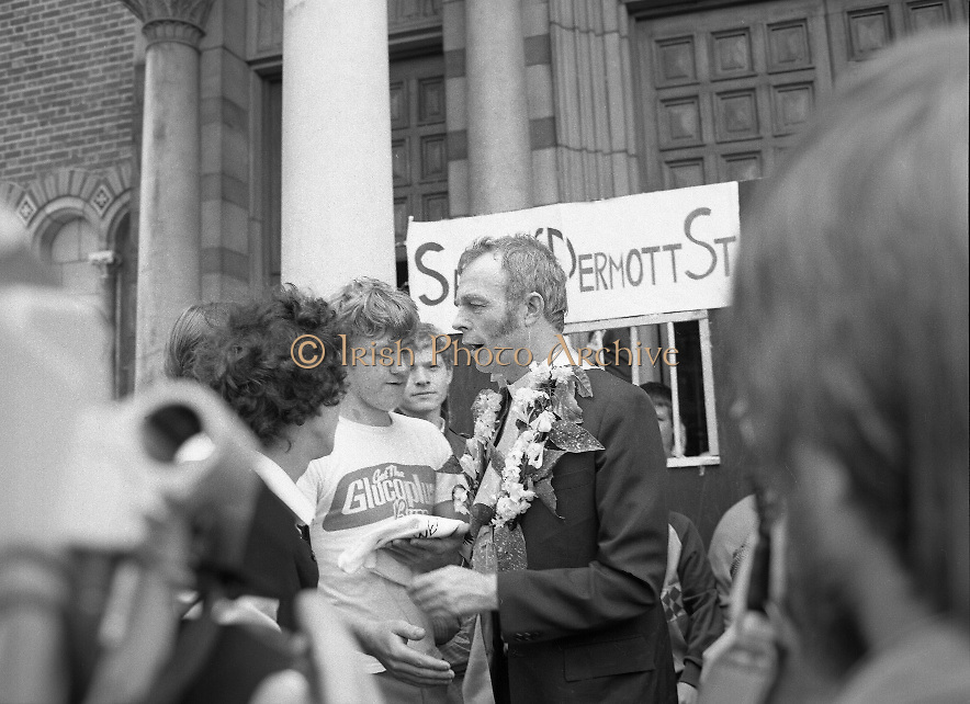 "Fr Niall O'Brien Returns from Captivity.1984..14.07.1984..07.14.1984..On 6 May 1983,Fr Niall O'Brien was arrested along with two other priests, Fr. Brian Gore, an Australian, Fr. Vicente Dangan, a Filipino and six lay workers - the so-called ""Negros Nine"", for the murders of Mayor Pablo Sola of Kabankalan and four companions. The priests where held under house arrest for eight months but ""escaped"" to prison in Bacolod City, the provincial capital, where they felt they would be safer.The case received widespread publicity in Ireland and Australia, the home of one of the co-accused priests, Fr. Brian Gore. When Ronald Reagan visited Ireland in 1984, he was asked on Irish TV how he could help the missionary priest's situation. A phone call the next day from the Reagan administration to Ferdinand Marcos resulted in Marcos offering a pardon to Fr. O'Brien and his co-accused..(Ref Wikipedia)...Fr O'Brien is welcomed after his ""Release"" from Sean McDermott Street Jail"