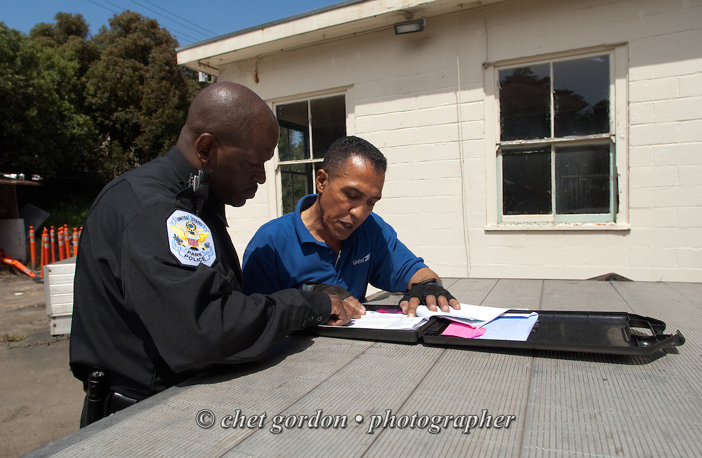 Over the road driver Jose Williams (right) speaks with a customer after a delivery in San Francisco, CA on Wednesday, April 22, 2015. Williams, a cross country trucker with a national household moving company, made several delivery stops in central California's Bay Area during the week with loads from Virginia originating on April 16th.  © Chet Gordon/THE IMAGE WORKS