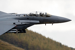 United States Air Force McDonnell-Douglas F-15E Strike Eagle (LN 92-364) from the 48th Fighter Wing, 494th Fighter Squadron based at RAF Lakenheath, England, flies low level through the Mach Loop, Machynlleth, Wales, United Kingdom