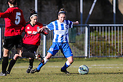 Brighton's Charlotte Owen shields the ball from Laura Espana during the FA Women's Sussex Challenge Cup semi-final match between Brighton Ladies and Hassocks Ladies FC at Culver Road, Lancing, United Kingdom on 15 February 2015. Photo by Geoff Penn.