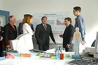 """24 JUN 2003, BERLIN/GERMANY:<br /> Edelgard Bulmahn, SPD, Bundesbildungsministerin, Gerhard Schroeder, SPD, Bundeskanzler, und Reinhard Uppenkamp, Vorstandsvorsitzender Berlin Chemie AG, im Gespraech mit einem Auszubildenden (v.L.n.R.),  waehrend einem Besuch der Berlin-Chemie AG im Rahmen einer Sitzung des Runden Tisches """"Ausbilden jetzt - Erfolg braucht alle"""", Berlin-Chemie AG<br /> IMAGE: 20030624-01-014<br /> KEYWORDS: Gerhard Schröder"""