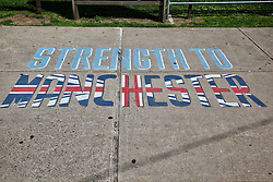 June 10, 2017 - Toronto, ONTARIO, Canada - The words 'Strength to Manchester' painted with the colours of the United Kingdom flag in Toronto, Canada, on June 10, 2017, as a tribute to victims of the terror attack carried out by the Islamic State in Manchester, England recently. Twenty two people were killed and fifty nine people injured after a suicide bomber targeted fans leaving a concert of American singer Ariana Grande at the Manchester Arena. ISIS has claimed responsibility for the deadly attack. (Credit Image: © Creative Touch Imaging Ltd/NurPhoto via ZUMA Press)